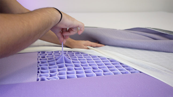 man demonstrating stretch of the Purple grid