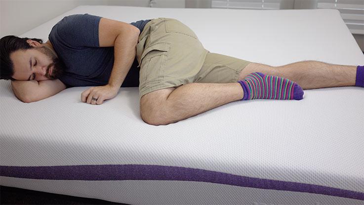 Purple mattress, man side sleeping