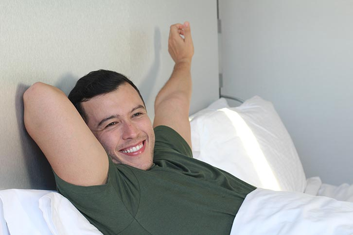 man waking up energetic smile