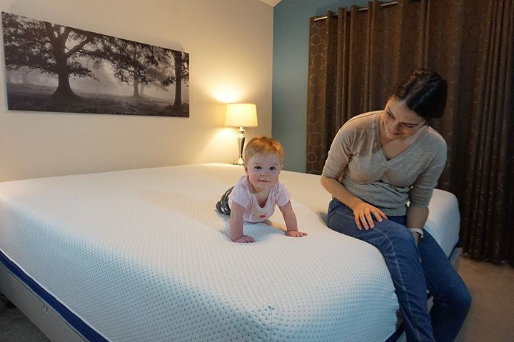 Mom and baby on the Amerisleep AS5 mattress