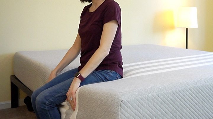 Woman sitting on edge of Leesa Mattress