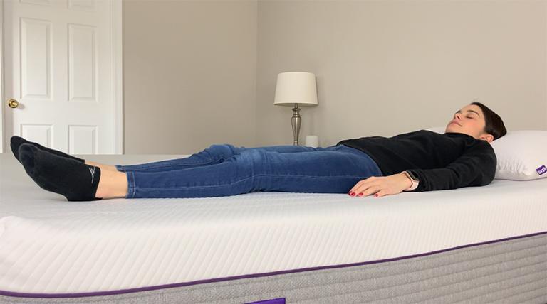Woman lying on her back on the Purple Hybrid Premier Mattress