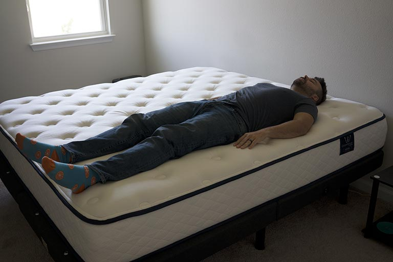 Man sleeps on back on the GravityLux mattress