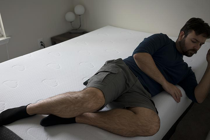 man demonstrating side sleeping